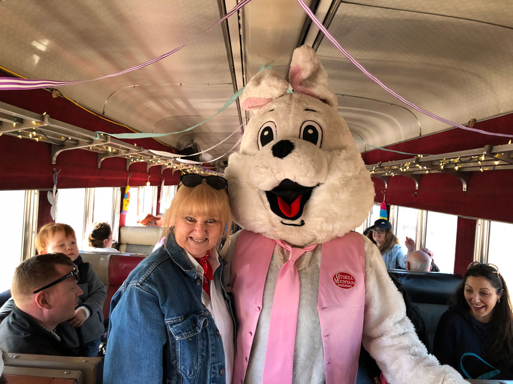 Easter Bunny posing with woman on bus
