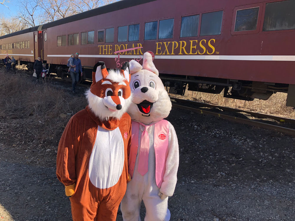 Fox and Bunny posing in front of train
