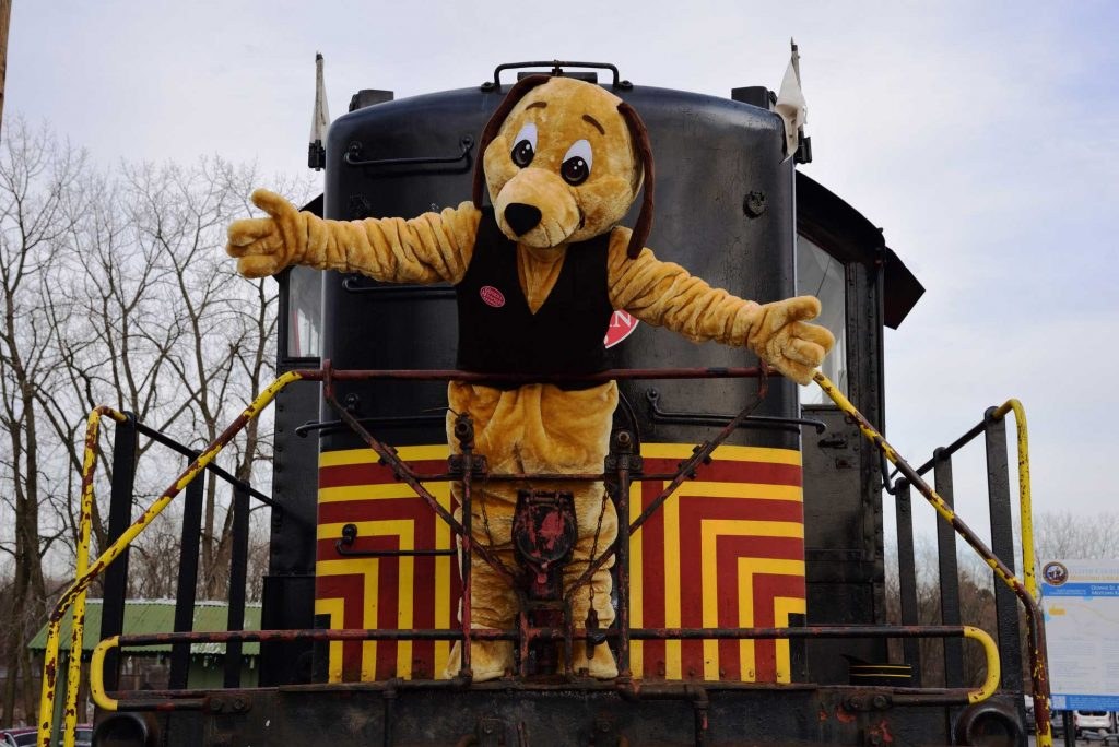 Catskill Mountain Railroad Train with Mascor dog character standing in front