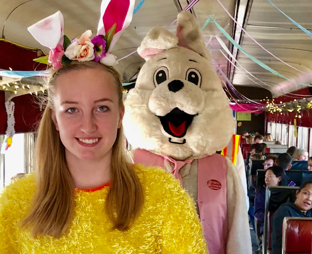Easter Bunny posing with girl on bus