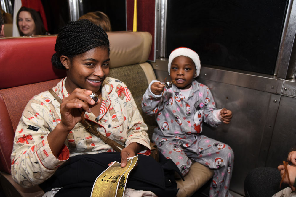 Smiling mom and kid aboard the Polar Express