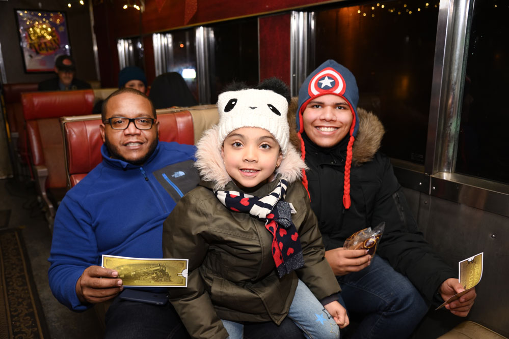 Smiling family aboard the Polar Express