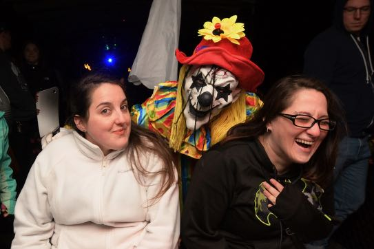 creepy clown and two people