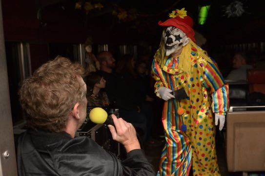 creepy clown with person