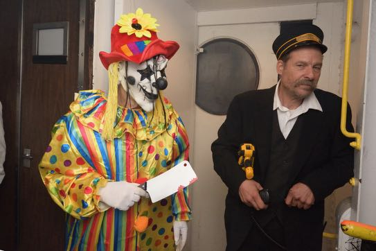 creepy clown with conductor